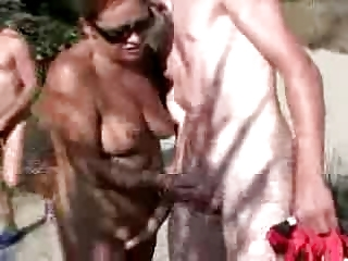 83 years old wife with youthful chap in the beach
