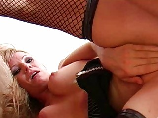 Blonde momma in red panties and fishnet stockings