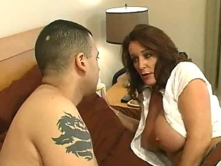 mature slut with large tits gets a bedroom milf
