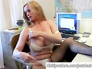 Busty cougar in fishnet stockings