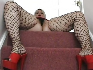 fat uk milf hottie posing in dark fishnets