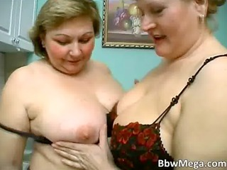 Sexy blonde chubby MILF hoes make out