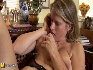 Hot American cougar mom masturbates while talking