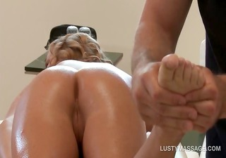 Blonde temptress gets ass and cunt oil massaged